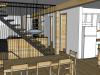 Vue d'ensemble à partir de la salle à manger. La cuisine à droite, le salon au fond et l'escalier.