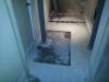 Percée dans la dalle pour inspecter les assises des colonnes