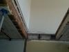 Percée de l'escalier dans le plafond du salon double.