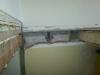 Percée de l'escalier dans le plafond du salon double. On voit la jonction entre l'ancien plancher et le mur mitoyen.