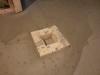 Auto-nivelant au sous-sol autour du drain de plancher
